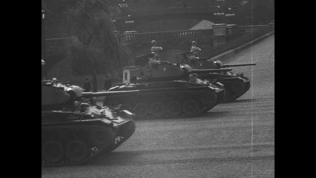 trucks carrying us soldiers drive by in formation crowd in foreground watching / tanks roll by / tanks roll by three abreast / standing and watching... - korean war stock videos and b-roll footage