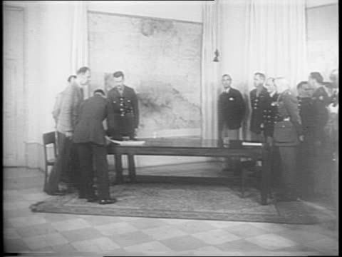 vidéos et rushes de trucks drive outside caserta palace / general heinrich vietinghoffscheel and karl wolff enter / general wd morgan / german general and morgan signs... - 1945