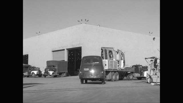 WS PAN Trucks driving in and out of factory / United States