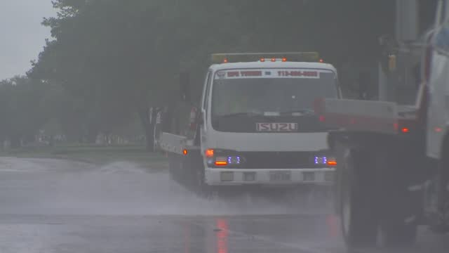 trucks driving through flooded roadways after hurricane harvey in houston, texas. - environment or natural disaster or climate change or earthquake or hurricane or extreme weather or oil spill or volcano or tornado or flooding stock videos & royalty-free footage