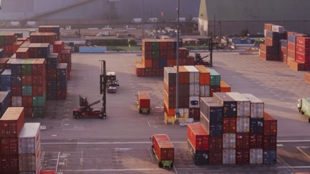 trucks in a row in container port - drone shot - container stock videos & royalty-free footage