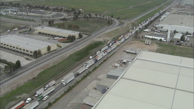 AERIAL, Trucks in line at Mexico and United States border