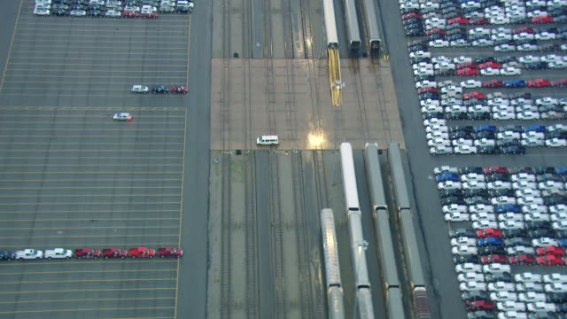 ms aerial zo f150 trucks in parking lot next to train at ford rouge truck plant / dearborn, michigan, united states - dearborn michigan stock videos and b-roll footage