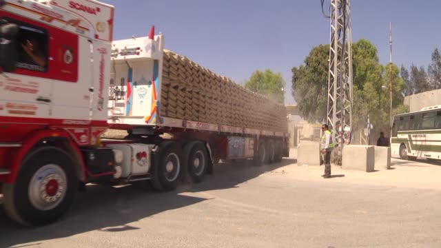 trucks loaded with construction materials, cross into gaza from the rafah border crossing on the border between egypt's sinai and gaza strip on may... - gaza strip stock videos & royalty-free footage
