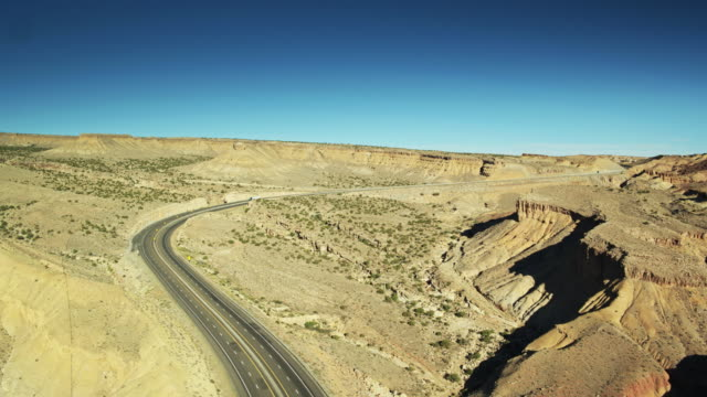 trucks on i-70 - drone shot - san rafael swell stock videos and b-roll footage