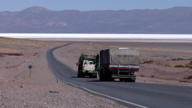 ws zo trucks on road crossing desert landscape, san pedro de atacama, el loa, chile - san pedro de atacama stock videos & royalty-free footage