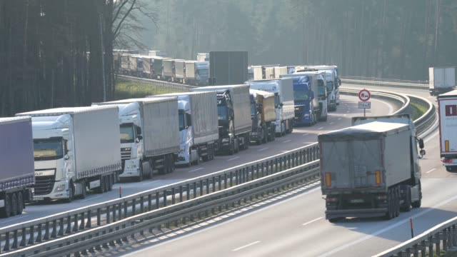 trucks on the a12 highway stand backed up approximately 70km before germany's border to poland on march 18 2020 near spreenhagen germany the polish... - polen stock-videos und b-roll-filmmaterial