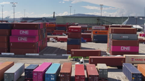 trucks passing each other in shipping yard - aerial - truck stock videos & royalty-free footage