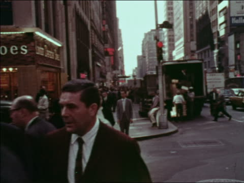 1969 trucks + people crossing street at intersection / nyc / industrial - 積荷を降ろす点の映像素材/bロール