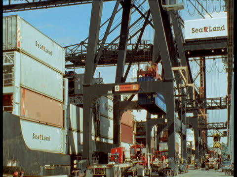 trucks queue up to take containers as they are unloaded from ship, anchorage, alaska - anchorage alaska stock videos & royalty-free footage