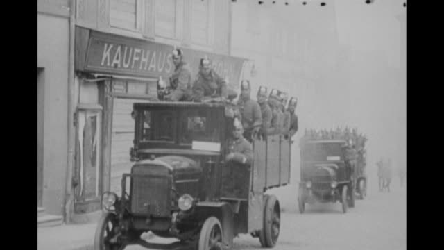 trucks spewing smoke come to a stop and uniformed policemen jump down from the flatbed and all stand together // exterior of the moritzburg fortified... - dresden germany stock videos & royalty-free footage