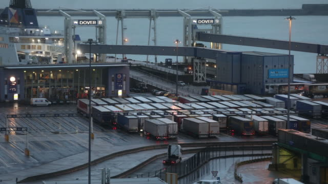 trucks stand on the dockside at the port of dover ltd at dawn in dover, uk on thursday, october 15, 2020. european leaders will gather in brussels... - morning stock videos & royalty-free footage