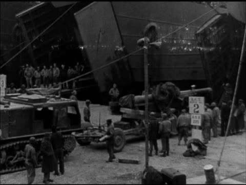trucks tanks artillery soldiers mobilizing onto transport carrier ships barrage balloons floating above ships ship sailing world war ii wwii us navy... - allied forces stock videos and b-roll footage
