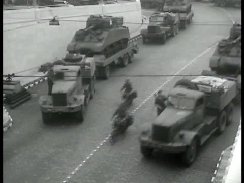 vidéos et rushes de trucks transporting british tanks on road ha ws trucks pulling trailers w/ tanks motorcycles ws army trucks leaving motor pool ms horse pulling... - 1944
