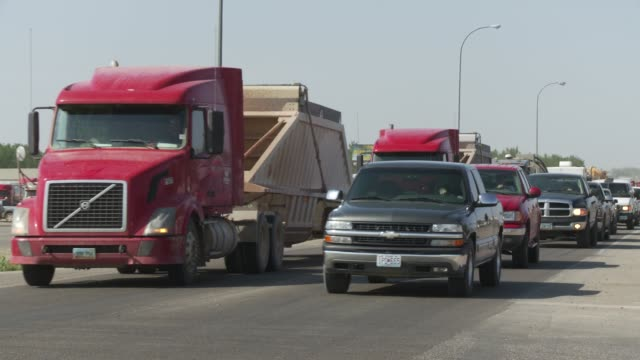 Trucks travel away from the Bakken oil fields in Williston, North Dakota.
