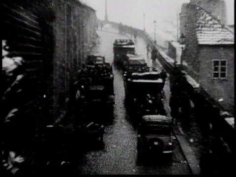 trucks traveling down city street / government building / nazi troops marching / hilter arriving by car - tilt down stock videos & royalty-free footage