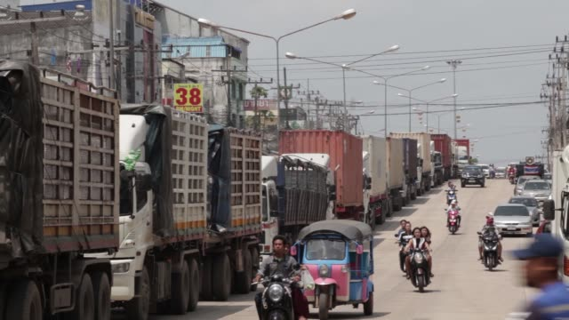 trucks wait to cross the border into malaysia at the border checkpoint of sadao songkhla province thailand on friday oct 16 vehicles pass a row of... - songkhla province stock videos and b-roll footage