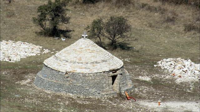 trulli, or dry stone huts  - aerial view - apulia, barletta - andria - trani, andria, italy - hut stock videos and b-roll footage