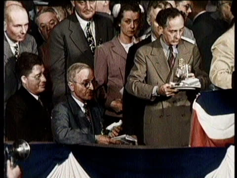 truman seated on stage at convention, eating a sandwich / wide shot of press looking up at stage / he hits a gavel before speaking at a microphone /... - harry truman stock videos & royalty-free footage