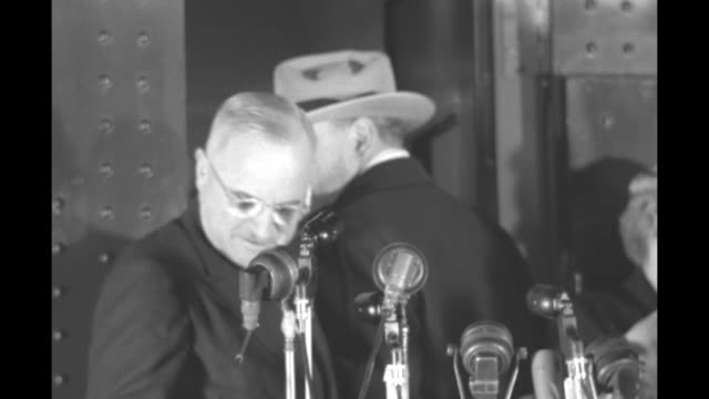 stockvideo's en b-roll-footage met truman standing on platform on end of train in train station speaking mayor of washington dc f joseph donohue standing next to him / vs truman... - margaret truman