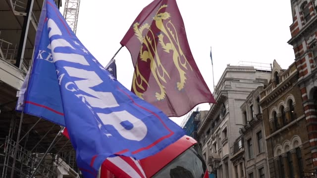 trump 2020 flags flies along side a flag of the united states and royal arms of england during standupx march for freedom protest on october 17, 2020... - side view stock videos & royalty-free footage