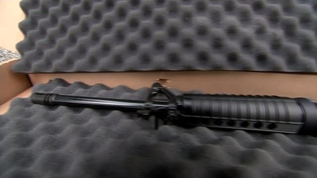 Trump and Congress discuss gun laws INT Assault rifle in case Close shot gun trigger Gun barrel