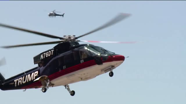 wjw trump helicopter lands and donald trump exits at the 2016 rnc near the cleveland quicken loans arena on july 20 2016 - republikanischer parteitag stock-videos und b-roll-filmmaterial