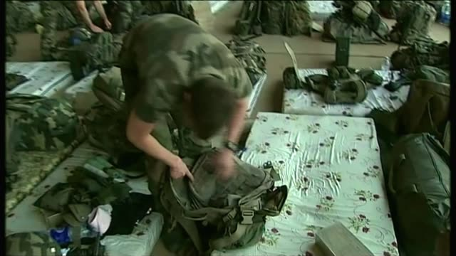 Trump row with widow of soldier escalates T16011303 / Bamako INT French troops packing their belongings in airport hangar ready to head north Soldier...