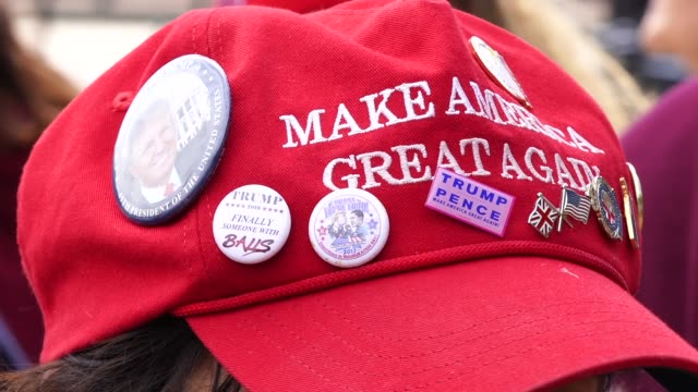 a trump supporter wearing a 'make america great again' baseball cap at protests against president donald trumpon june 3 2019 in london england - donald trump us president stock videos and b-roll footage