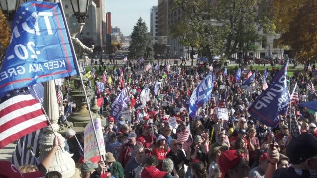 vídeos de stock e filmes b-roll de trump supporters congregate at the michigan state capitol building to voice their grievances after democratic candidate former vice president joe... - partidário