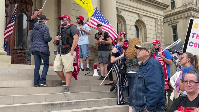 """trump supporters demonstrate at the michigan state capitol on november 08, 2020 in lansing, michigan. militia members had pledged to attend the """"stop... - michigan stock-videos und b-roll-filmmaterial"""