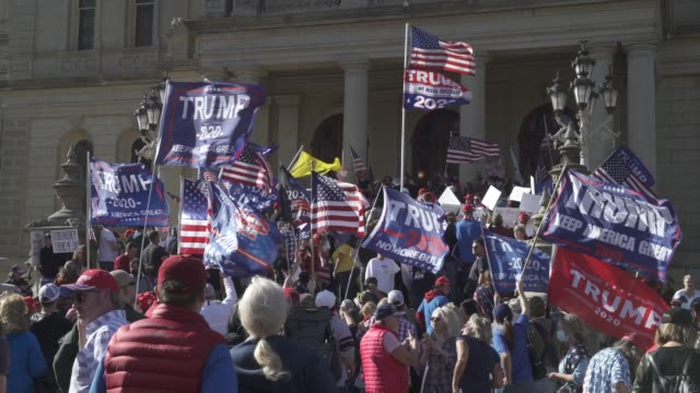 trump supporters hold up religious statutes at the michigan state capitol building to voice their grievances after democratic candidate former vice... - presidential candidate stock videos & royalty-free footage