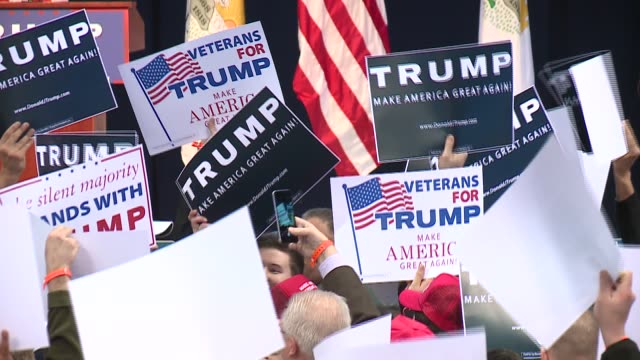 WGN Trump Supporters Hold Up Signs At Rally That Was Later Canceled at the UIC Pavilion in Chicago on March 11 2016