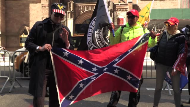 trump supporters in maga hats flags in front of trump tower on 5th avenue altercation when jovi val brings a confederate flag argument ensues nypd... - confederate flag stock videos and b-roll footage