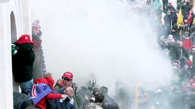 """trump supporters outside the u.s. capitol hill building for the """"million maga march - stop the steal"""" rally contesting the certification of the 2020... - capitol hill video stock e b–roll"""