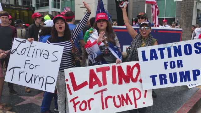 vídeos de stock, filmes e b-roll de trump supporters rally - latinas4trump - los angeles - hollywood califórnia