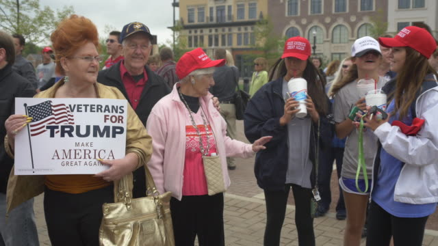 Trump supporters wait in line to hear 2016 Republican presidential candidate Donald Trump speak during a campaign stop and town hall at the Palladium...