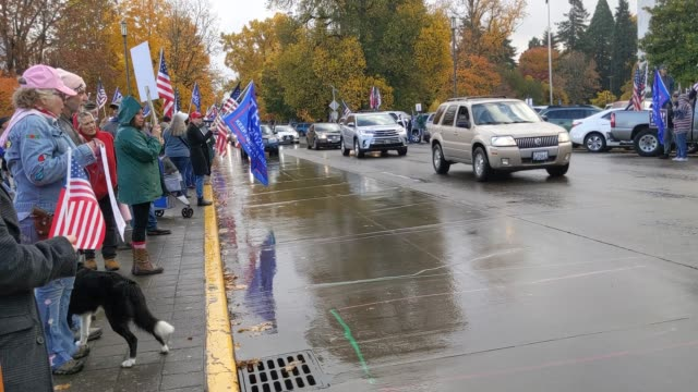 "trump supporters wave at cars passing during ""stop the steal""protests on november 7, 2020 in salem, oregon. angry supporters of president trump took... - oregon state capitol stock videos & royalty-free footage"