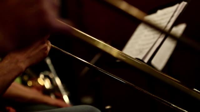 trumpet and trombone playing jazz music - trombone stock videos & royalty-free footage