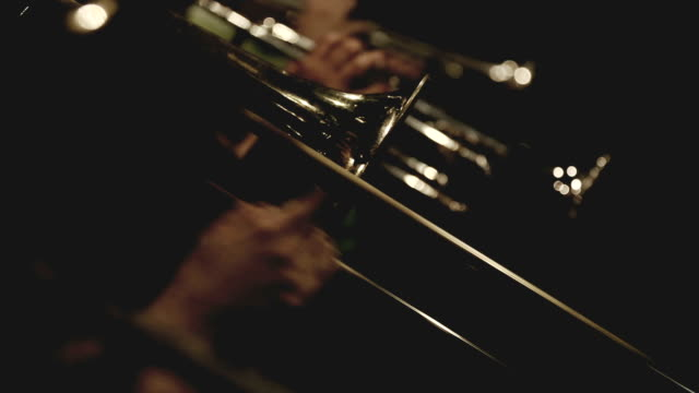 trumpet and trombone playing jazz music - performance group stock videos and b-roll footage