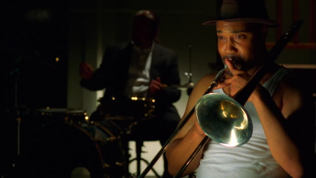 trumpet player with drummer in background - jazz stock videos & royalty-free footage