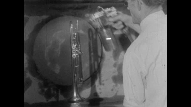 trumpets in instrument factory; 1956 - 1956 stock-videos und b-roll-filmmaterial