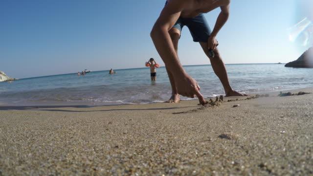try to write beach love - byakkaya stock videos and b-roll footage