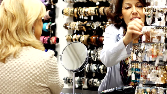 trying on earrings - earring stock videos and b-roll footage