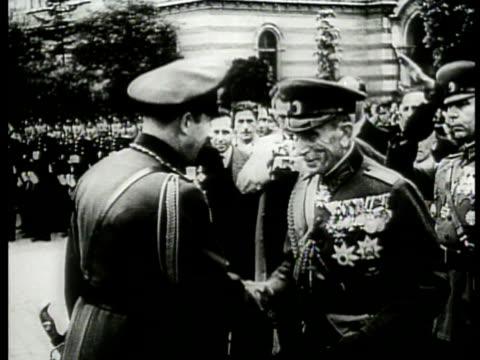 tsar boris iii of bulgaria shaking hands w/ unidentified highly decorated elder male. mot 1943: bulgaria: bulgarian soldiers marching. nazi german... - insignier bildbanksvideor och videomaterial från bakom kulisserna