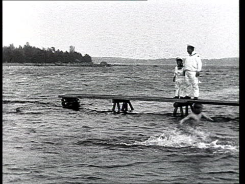 tsarevich alexei /young tsar / czar son of nicholas ii in canoe w/ friends small naked children jumping off pier into lake young tsar watching line... - jungen stock-videos und b-roll-filmmaterial