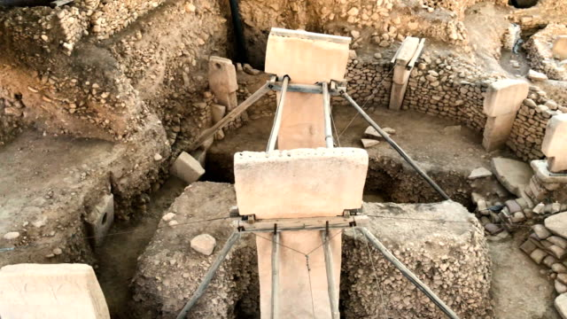 tshaped pillars are seen at the gobekli tepe archaeology site on september 18 2018 in sanliurfa turkey since it's discovery the 'gobekli tepe' site... - four animals stock videos & royalty-free footage