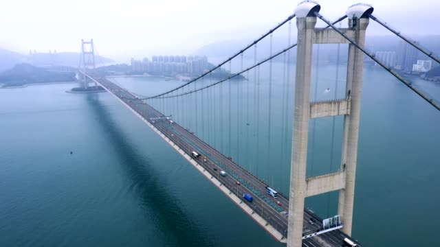 stockvideo's en b-roll-footage met tsing ma bridge in mistige dag, hong kong - staal