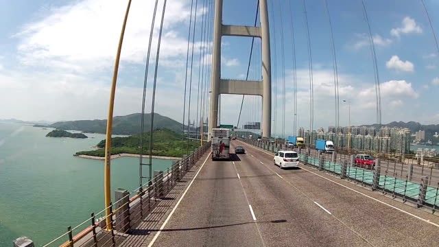 tsingma bridge and hong kong international airport - hanging stock videos & royalty-free footage