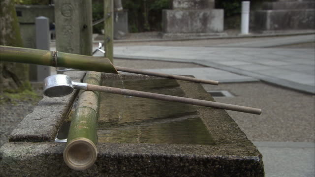 cu tsukubai and metal scoop, kyoto, japan - tsukubai stock videos and b-roll footage